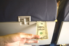 dollar-seatback-airline-fees-hikes.jpg